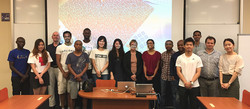 Students and staff with Prof. Cassim